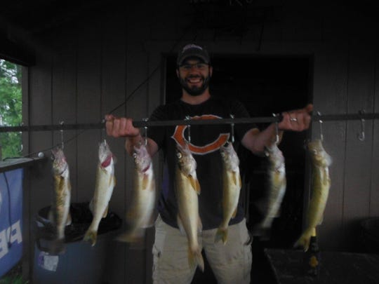 Rob Murray shows some of the fish he caught on Stevens Point flowage in May. The Murrays have hired Kenny Wallock of Kenny Wallock Professional Guiding as a guide several times a year for more than 15 years.