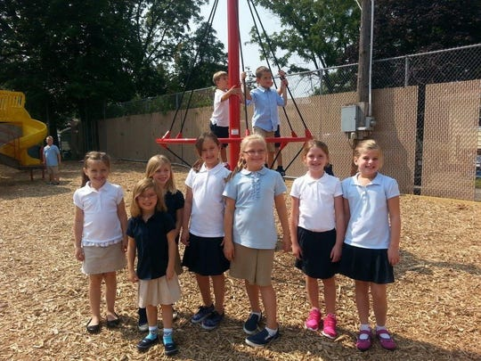 Haylie Lynch (from left) Ashlyn Pauly, Breelyn Pauly, Lorelai Sonnenburg, Haley Quimby, Hope Dunaway and Mary McCurdy show off the new playground equipment at St. Mary Elementary School.
