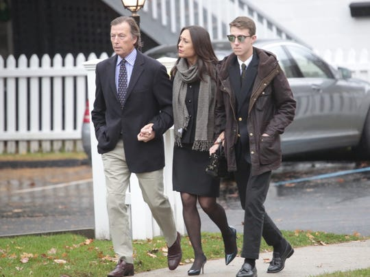 Bruce Colley with his wife Teresa and son Davis enter
