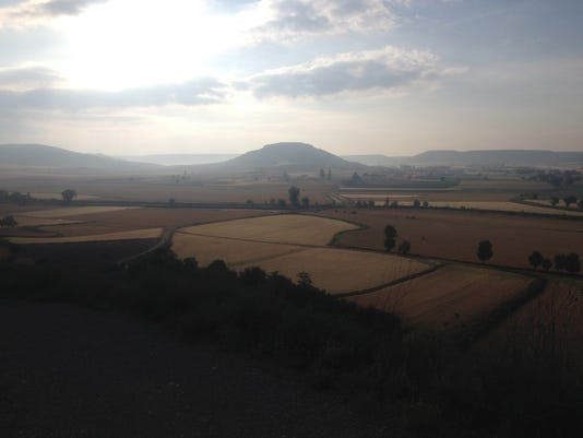 Looking back at the morning light from the rising sun feels sacred. View from high a hill on the 500 mile Camino pilgrimage in Spain