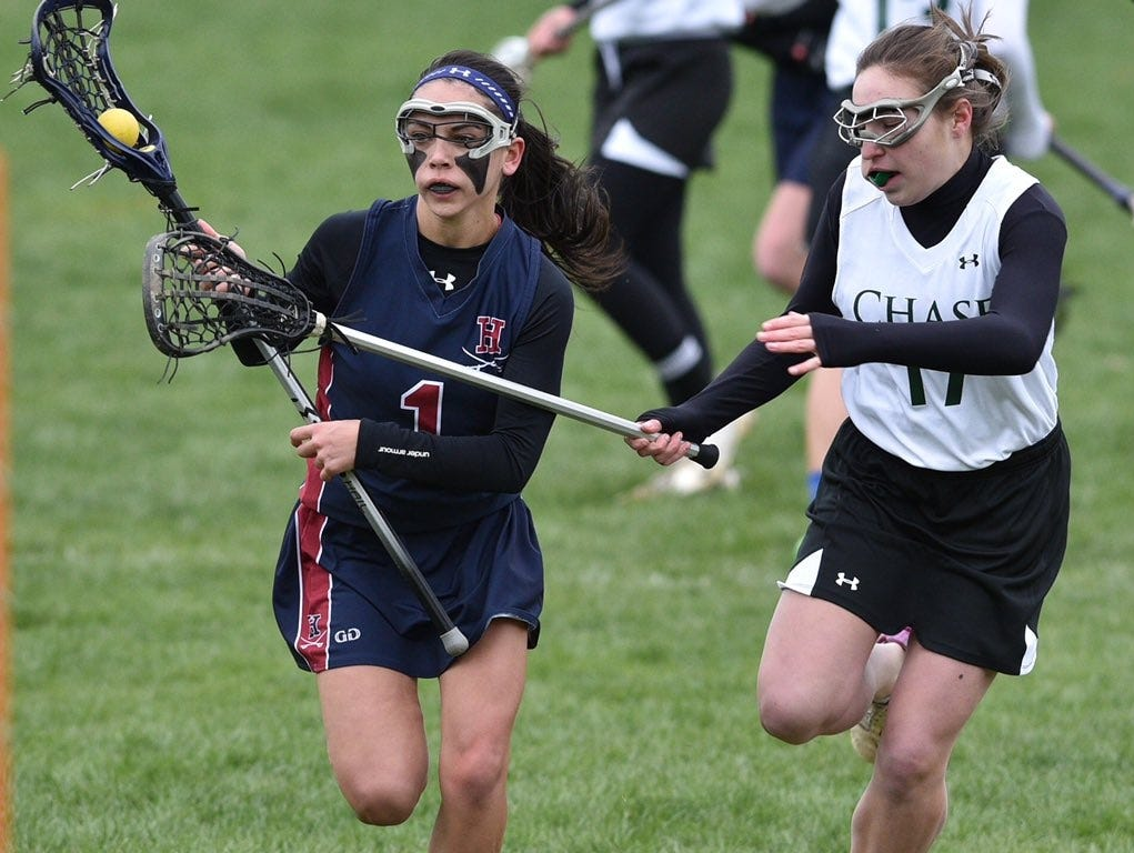 Harvey's Julia Mallon (left) controls the ball during a game against Chase Collegiate on Wednesday, April 6th, 2016.