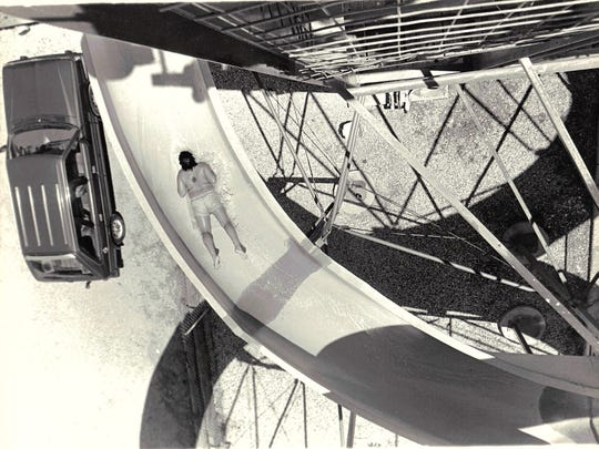 An unknown man rides down the giant water slide at Fun City, 3904 National Parks Highway, circa June 1986.