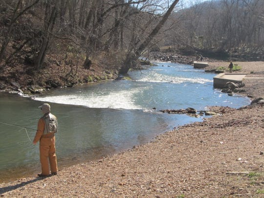 A trout angler enjoys the solitude that the winter trout fishing at Roaring River offers.