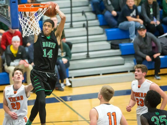 Oshkosh North's Tyrese Haliburton goes up for a dunk shot during a non-conference tournament game at Oshkosh West High School against Marshfield on Saturday, Nov. 25, 2017.