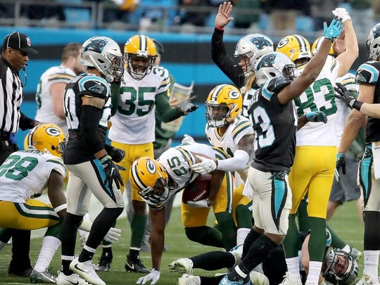 Green Bay Packers defensive back Marwin Evans (25) comes out of the pile with the ball after an onside kick in the fourth quarter against the Carolina Panthers on Sunday, Dec. 17, 2017 at Bank of America Stadium in Charlotte, N.C.