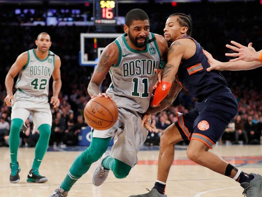 Boston Celtics guard Kyrie Irving (11) drives past