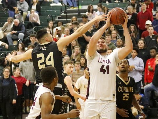 Dan Fedor of Elmira goes up for a shot as Jason Rodriguez of Corning defends Tuesday during a Section 4 Class AA semifinal at Elmira High School.