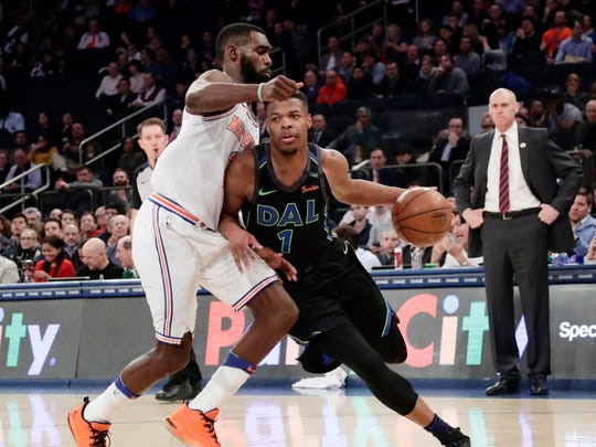Dallas Mavericks' Dennis Smith Jr. (1) drives past New York Knicks' Tim Hardaway Jr. (3) during the first half of an NBA basketball game Tuesday, March 13, 2018, in New York.