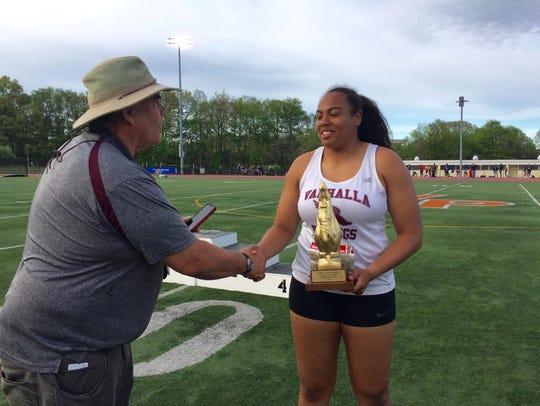 Valhalla's Sam Morillo receives a trophy after winning