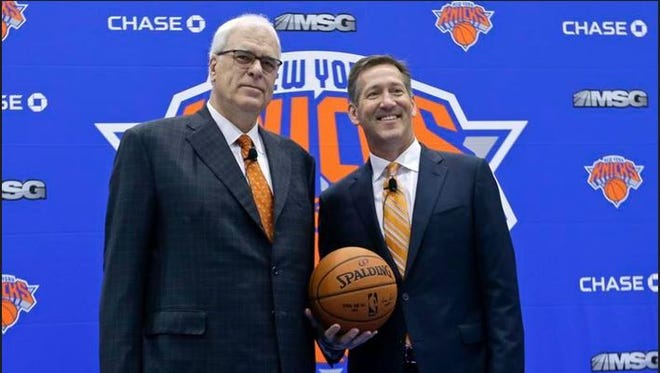 New York Knicks President Phil Jackson, left, and head coach Jeff Hornacek pose for photographs during a news conference to announce the hiring of Hornacek as the head coach Friday, June 3, 2016, in Tarrytown.