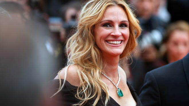 Oh, the life of Julia Roberts. One day she's visiting Children's First Academy in Phoenix; another day, she's on the red carpet at the Cannes Film Festival on May 12, 2016.