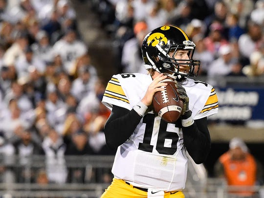 Iowa Hawkeyes quarterback C.J. Beathard (16) drops