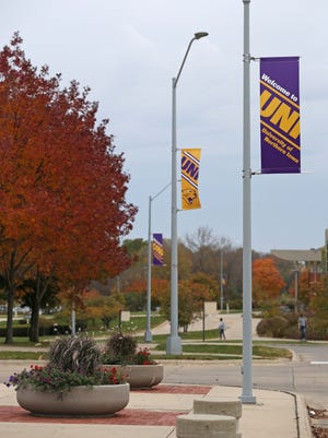 The leaves on the University of Northern Iowa campus are beginning to turn shades of yellow, red and orange on Wednesday, Oct. 21, 2015, in Cedar Falls.
