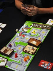 People play Munchkin, one of more than 700 board games that are available to patrons of Zander's Game House in Camarillo.