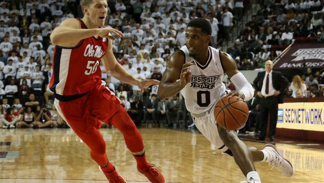 Mississippi State Bulldogs guard Nick Weatherspoon (0) drives to the basket against Rebels forward Justas Furmanavicius.
