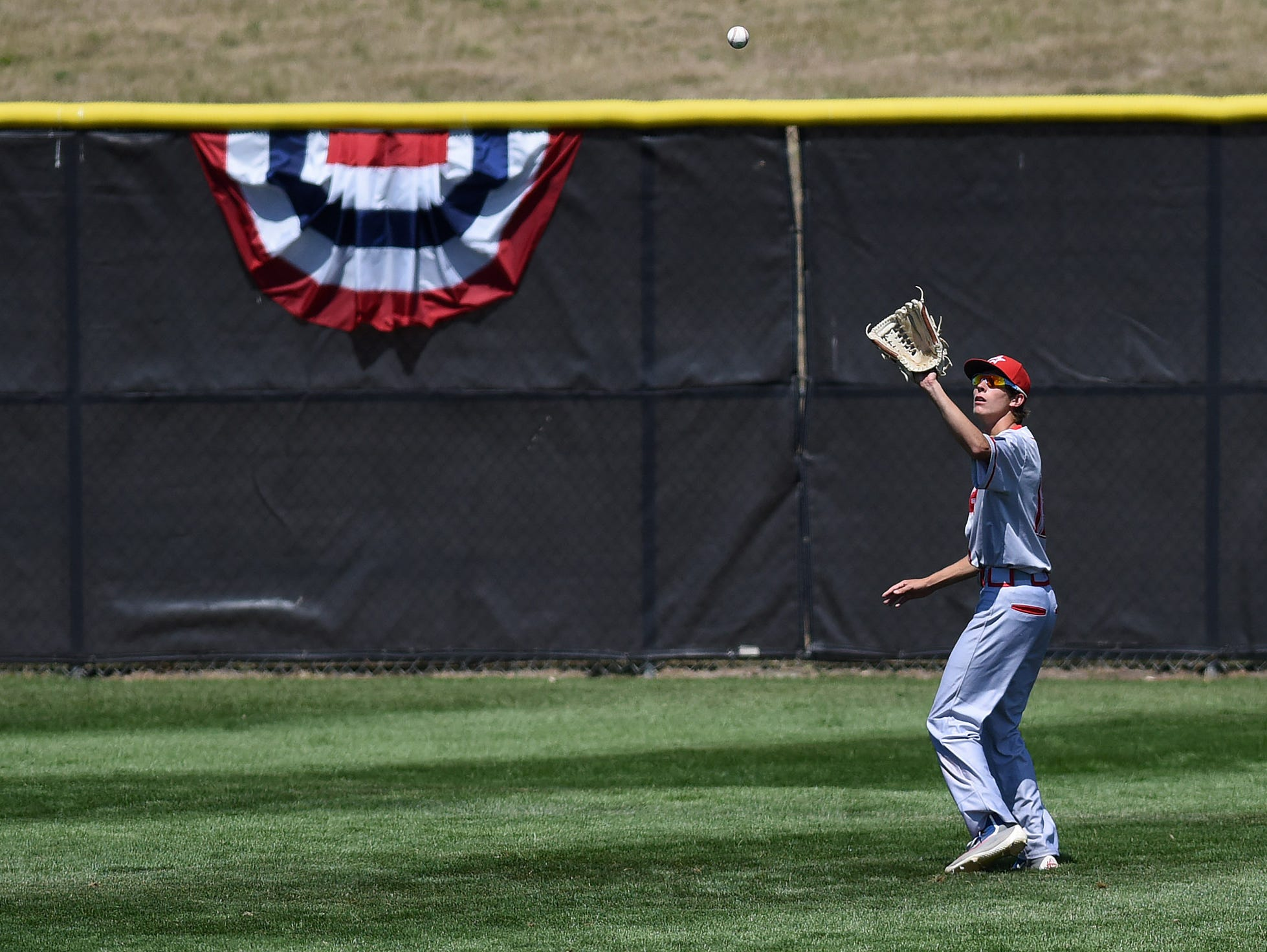 Rapid City Post 320's Zane Salley catches the ball against Sioux Falls East Post 15 during the American Legion Class A Baseball State Tournament at Harmodon Park on Saturday afternoon.