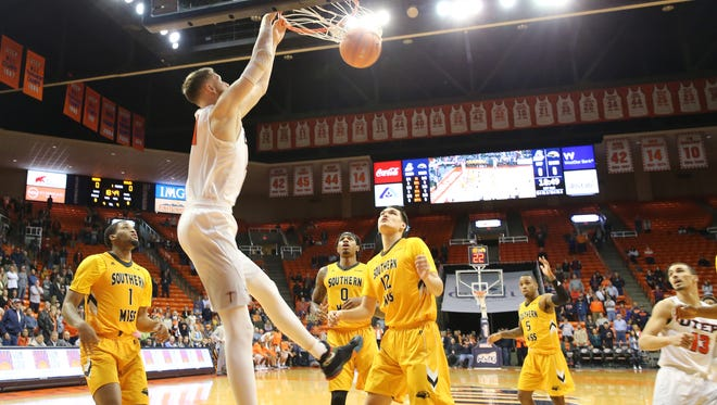 UTEP senior Matt Willms dunks while Southern Miss players watch in UTEP's victory Saturday night in the Don Haskins Center.