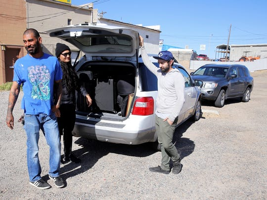 OJ Kaminky, left, Brandon Mike and Eddie Jacquez load their equipment before heading to Gallup for a show on April 14.