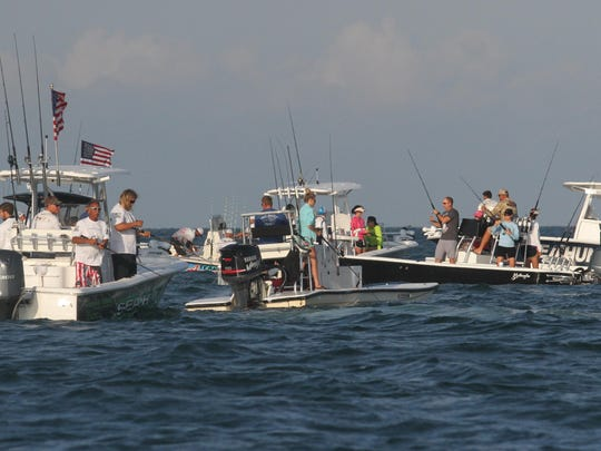 Anglers participating in the Professional Tarpon Tournament Series follow a school of tarpon through Boca Grande Pass.