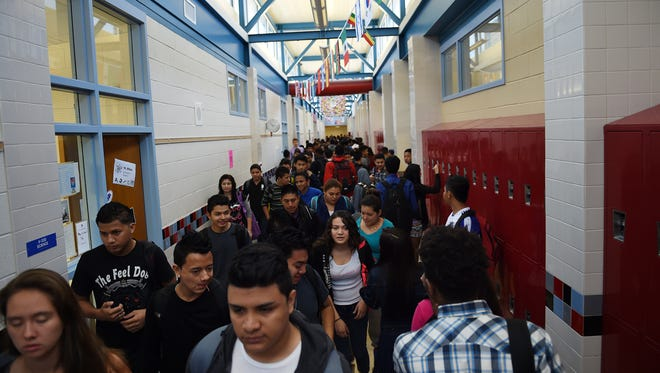 Students pack the hallways between classes at T.C. Williams High in Alexandria, Va. in September 2014. The high school was part of a now-defunct federal turnaround program that led to a change in principals.