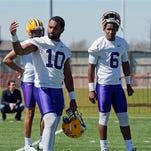 LSU quarterbacks Anthony Jennings (10) and Brandon Harris (6) chat after practice.