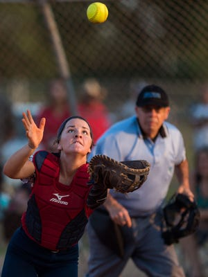 Master's Academy catcher Carina Fowler catches a bunt that popped up from Vero Beach's Kayla Welsh during the fourth inning of the high school softball game Friday, April 20, 2018, Vero Beach High School.