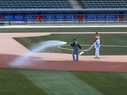 Grounds crews prepare Victory Field in Indianapolis on Monday, April 6, 2015 for the first home game of the Indianapolis Indians on Thursday night.