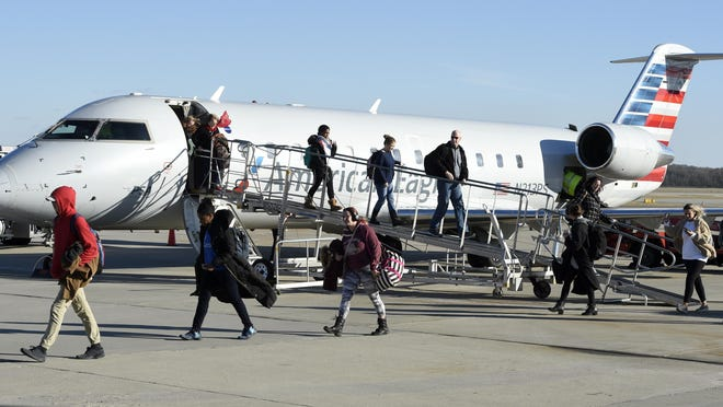 Passengers walk off the first American Airlines flight from Washington D.C. at Augusta Regional Airport in Augusta, Ga., Tuesday afternoon January 7, 2020. The daily flight is currently suspended due to the pandemic.
