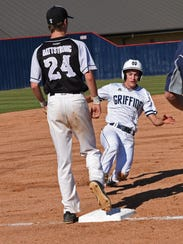North DeSoto's Carson Curtis is safe at third in their