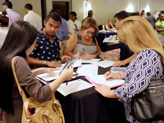 Weekly jobless claims fall to 265,000