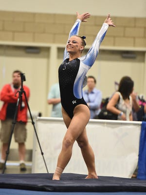 Kara Roberts of Pinckney recently signed a national letter of intent with Eastern Michigan University gymnastics after committing as a freshman.