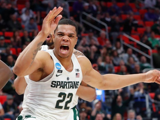 Michigan State guard Miles Bridges (22) celebrates a dunk against Bucknell during the second half of an NCAA men's college basketball tournament first-round game in Detroit, Friday, March 16, 2018. (AP Photo/Paul Sancya)