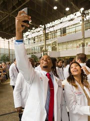 Students pose for a selfie after Friday's White Coat Ceremony for Rutgers Robert Wood Johnson Medical School students in New Brunswick.