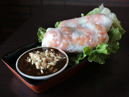 The Shrimp Spring Roll is stuffed with fresh lettuce, cucumbers, cilantro, long pickled carrots, vermicelli noodles and jumbo shrimp, all bursting with flavor. It comes with a tasty peanut sauce.