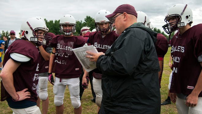 BFA-Fairfax football coach Mike Williams talks to his players during a scrimmage against Milton earlier this month. Eight players on this year's Fairfax team hail from outside the school district.