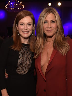 Julianne Moore, left, and Jennifer Aniston attend the