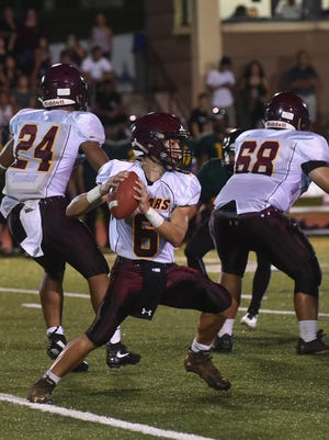 In this file photo, the Father Duenas Friars play the JFK Islanders in the IFL. The Friars face the Okkodo Bulldogs tonight.