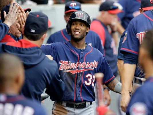 Minnesota Twins' Danny Santana (39) celebrates with teammates after scoring on a single hit by Trevor Plouffe  during the eighth inning of a baseball game against the Chicago White Sox in Chicago, Sunday, Aug. 3, 2014. (AP Photo/Nam Y. Huh)