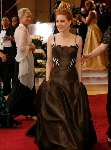 Amy Adams has long wowed us on the red carpet, but her Academy Awards style has become more refined and elevated over the years. Back in 2006, in a Carolina Herrera dress, her Oscar look meant a lot of everything: ruffle, texture and eye makeup galore.