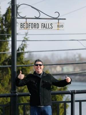 "Jeff DiVeronica stops for a picture on the bridge in Seneca Falls, the town that many think inspired Frank Capra to write ""It's a Wonderful Life."""