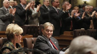 Assembly Minority Leader Peter Barca (D-Kenosha), center, remains seated with fellow Democrats as Republicans applaud Gov. Scott Walker during his state of the state speech in 2012.Wednesday night in the State Capitol. January 25, 2012.