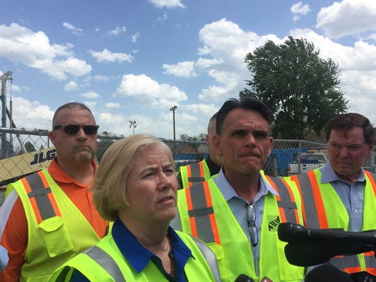 Macomb County Public Works Commissioner Candice Miller, center, talks about the sewer collapse and sinkhole on 15 Mile Road in Fraser on May 18, 2017. She is surrounded by, from left to right, Fraser Mayor Joe Nichols, Macomb County Executive Mark Hackel and Clinton Township Supervisor Bob Cannon.
