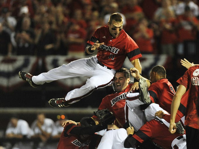 Louisville's Jeff Gardner (center) gets a hip to the head as teammate Zach Lucas (above) and the team celebrate a victory against Kennesaw State on Saturday during the Louisville Super Regional at Jim Patterson Stadium. The Cardinals won 7-4. June 7, 2014