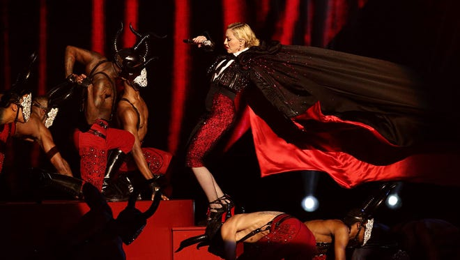 Madonna stumbles while performing on stage during the Brit Awards 2015 at the 02 Arena in London, Wednesday, Feb. 25, 2015.