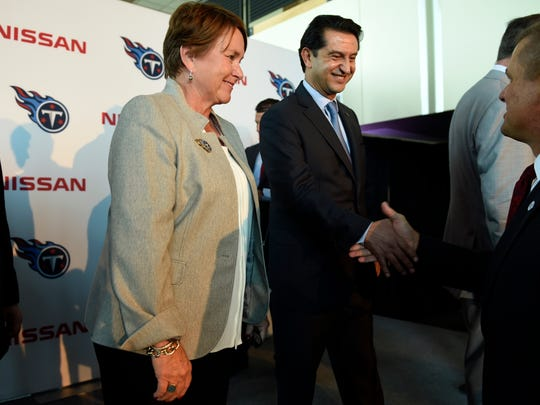 Titans co-owner Amy Adams Strunk and Nissan North America chairman Jose Munoz are congratulated by guests after an announcement that LP Field will now be called Nissan Stadium