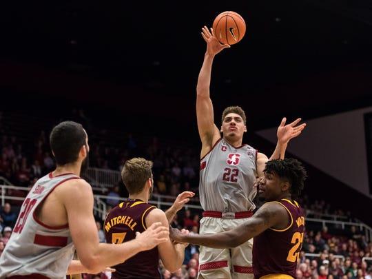 Stanford forward Reid Travis (22) attempts a shot against ASU on Wednesday.