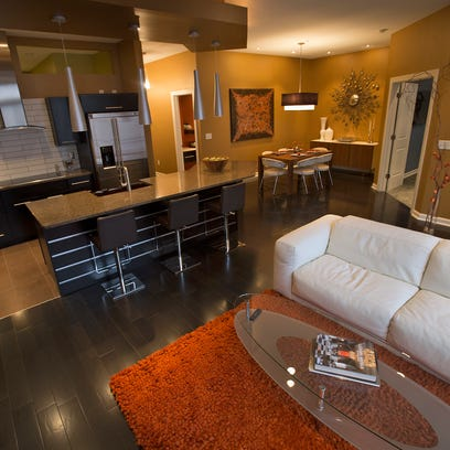 The main living area includes an open kitchen, dining
