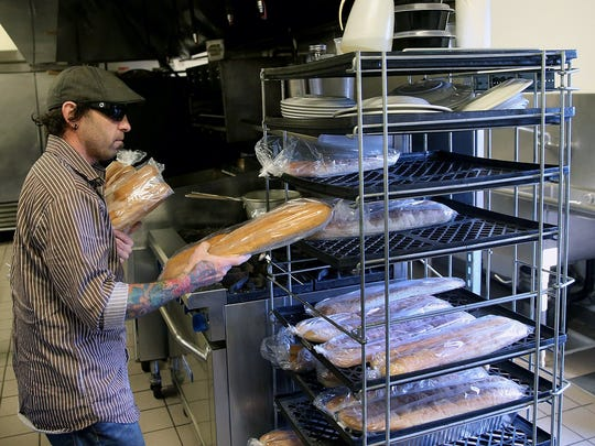 Trendy's Pizzeria in Keyport co-owner Will Shortway, stacks bread loaves on Wednesday, December 7, 2016.  The pizzeria is in the old Whiskey Creek Steakhouse location.