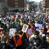"""Marc LeClair, of Wausau, Wis., center with sign, marches during a rally against a """"right-to-work"""" proposal, on Saturday, Feb. 28, 2015, in Madison, Wis. Thousands of Wisconsin union workers rallied at the Capitol Saturday to protest a """"right-to-work"""" proposal that would outlaw the mandatory payment of union dues, but the crowd was much smaller than those in 2011 against Gov. Scott Walker's law stripping public sector unions of much of their power."""