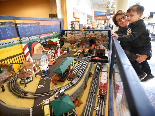 Andrew Imsschweiler, 4, and grandma and Palmyra native, Karen Stefan, watch as the trains round the track.
